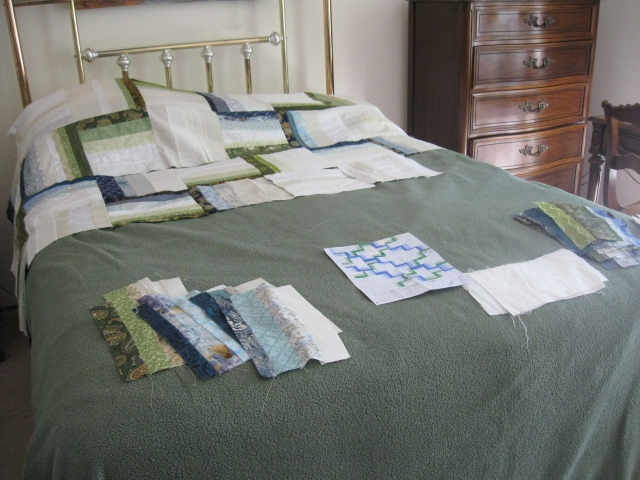 work in progress auction rail fence block quilt on bed